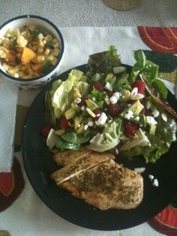 092012: Dinner: Grilled Chicken + Salad(s): Chicken: thin-sliced chicken breast, pan-seared in butter and olive oil, slathered with homemade basil + walnut pesto. Salad: Farmers' market lettuce mix + chard + kale + spinach + a little iceberg lettuce, raspberries, avocado, sliced almonds, goat cheese crumbles, green onion slices, dressed in homemade balsamic fig dressing. Side of the most amazing raw salad in the world: corn right off the cob, torn basil, chunks of peaches, sea salt. Love it love it love it love this salad. Not pictured: 2 glasses of decent cab, 2 slices of batard bread with butter and salt.