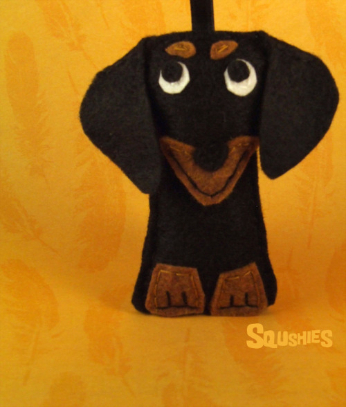 squshies:  Ralph the Dachshund Ralph is a car guy. His car is his baby. He loves it more than anything. Every chance he gets he's upgrading itwith after market parts, spoilers, body kits, and chrome. At this point you can hardly tell that Ralph's car is a Toyota Previa. Don't scoff at his mini van, with all the work he's done it has become an awe inspiring streak of chrome down the highway. (via squshies on Storenvy)