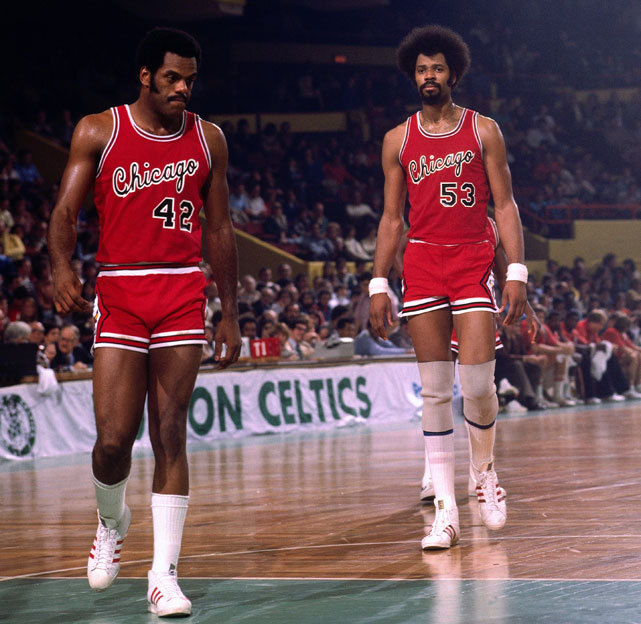 Scott May (No. 42) and Artis Gilmore walk onto the court during a 1976 Celtics-Bulls game. Gilmore is celebrating his 63rd birthday on Friday. (Dick Raphael/NBAE via Getty Images) SI VAULT: Switch to fast break has Gilmore, Colonels looking good (11.26.73)