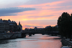 Sunset over the Seine in Paris, France.