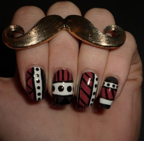 Day 16: Tribal Print There's a pretty long list of nail art designs that I can't do/don't like doing, and tribal print is one of the key ones on there (water marble is Public Enemy #1 on this list). I tried it anyway, and I don't hate it as much as I thought I would, but it's still pretty sloppy. I blame the lines.