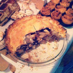 "PEAR, FIG & WALNUT PIE You've got to treat yo' yourself. Is it odd that I treat myself by baking something new? Buying life supplies has really gotten in the way of buying baking supplies. Socks or cream cheese? Shampoo or semi-sweet chocolate? Tampons or unsalted butter? When you're an independent woman you've got to prioritize. Anyway, we had a company barbeque this week. It was thrown by Italians, so instead of hamburgers, there was pasta. It also rained that day, so instead of socializing in a backyard, we just had free food and beer at the office. …So, it was like every other night! The point is, it was an excuse to bake something. At first I was overwhelmed. What to bake? What to bake! I have a never ending to-do-list and I wanted to splurge on ingredients.  Then I realized my hand mixer is broken. Which meant whatever I was going to bake had to be made completely by hand. Pie. (By the way, I've been pulling 14 hours at the office and didn't have any time to make this pie and ended up whipping it together over my lunch break. No big deal.) So, I wanted to try something a little different than a basic pie. This recipe really jumped out at me. It's a little more time consuming, but worth it. The flavours are complex, warm, and so delicious. (Although, I realized, even though it's an unexpected combination of ingredients, all pies look the same with a lid. Dang.) As I was scooping pie onto the Polish Prince's plate he said, ""Not so much, what if I don't like it?"" Oh how I laughed and laughed.  PEAR, FIG & WALNUT PIE1 recipe Pâte Brisée3/4 cup Marsala wine6 black figs, stemmed and quartered  3 stars of anise 3 lbs (about 6) barlett pears3/4 cup walnuts, chopped and toasted 1 lime, juiced1/2 cup granulated sugar1/4 tsp salt3 tbsp. cornstarch2 tbsp. unsalted butter, cut into small pieces1 egg yolk 1 tbsp. heavy creamSanding sugar, for sprinkling Bring wine, figs, and stars of anise to a boil in a small saucepan. Reduce heat, and simmer, 8 to 10 minutes. Use a slotted spoon to transfer figs to a large bowl. Cook reserved liquid over medium-high heat until reduced to a syrup, about 3 minutes. Discard stars of anise. Pour syrup over figs.Meanwhile, on a lightly floured surface, roll out 1 disc of dough to a 13-inch round. Fit into a 9-inch pie plate. Trim dough, leaving a 1-inch overhang. Refrigerate or freeze until firm, about 30 minutes. Roll out second disc to a 13-inch round. Lay dough round on a sheet pan and refrigerate or freeze until firm, about 30 minutes.Peel and core pears, slice into 1/4-inch thick wedges. Add pears, walnuts, lemon juice, granulated sugar, salt, and cornstarch to figs and syrup and stir until combined. Spoon into dough-lined pie plate, piling high in centre. Dot with butter, and lightly brush the edge of the dough with water. Drape second disc of dough over rolling pin, centre over the filling, and gently press the dough around the filling to fit. Trim the dough, leaving a 1/2-inch overhang. Fold the edge of the top crust under the bottom one, and crimp to seal. Combine yolk and cream together. Brush mixer all over the dough, and sprinkle the pie generously with sanding sugar. Freeze the pie until firm, about 30 minutes. Meanwhile preheat the oven to 400 degrees F, with rack on lower level.Transfer pie plate to a parchment or foil-lined rimmed baking sheet, and bake until just golden, 20 to 25 minutes. Reduce heat to 375 degrees F. Bake until juices are bubbling and crust is deep golden brown, about 1 hour (if edges brown too quickly, cover with foil). Let pie cool completely on a wire rack before slicing and serving.  Adapted from: Martha Stewart"
