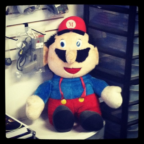 nikoanesti:  Don't be scared, kids! It's-a me, Mario! (Taken with Instagram at Next Level Video Games)  I used to have one of those. No, seriously. It's a Six Flags prize. My friend Andy won it at Six Flags in a ball toss game. Then I traded him a thing for it. To the best of my recollection, it was the Official Nintendo Player's Guide. Kinda odd seeing a photo one in such good condition. It must be about 25 years old.