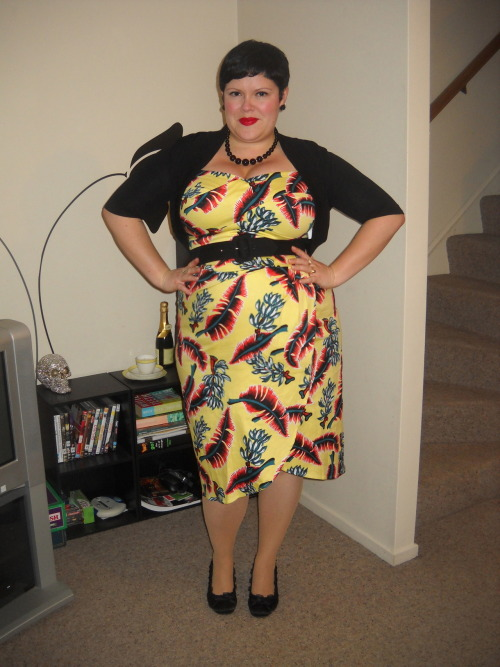 "ilikeprettyclothes:  I wore my Dixiefried Tiki Twist out for the first time last night. This style is a bit of a departure for me in terms of dresses, as it is more figure-hugging that the swing styles I usually wear. At first I was a little self conscious, I must admit, but throughout the night I felt better and better in it. By the end of the night, when I went to the bathroom and checked myself out in the full length mirror, I was like, ""Hot damn I look good!"" So there's that, ha ha. dress and belt - Pinup Girl Clothing, shrug - City Chic, nude fish nets - eBay, shoes - Number 1 Shoes, necklace - Walmart, earrings - Domino Dollhouse"