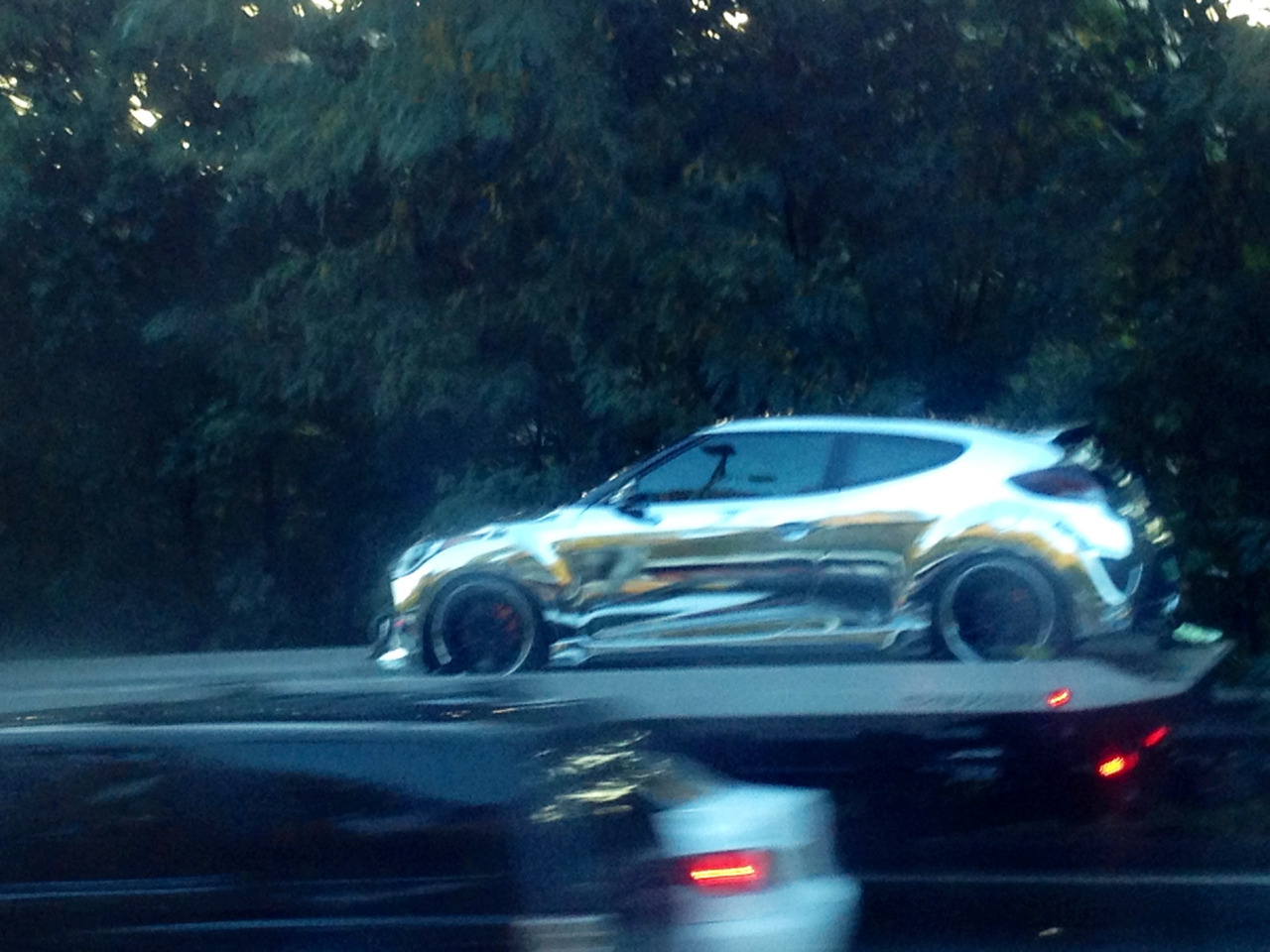 Check out what I just saw on my way home from work, a chromed Veloster on a flatbed truck! A bit hideous but I couldn't resist taking a shotty iphone photo from the bus. Wonder where it's going?