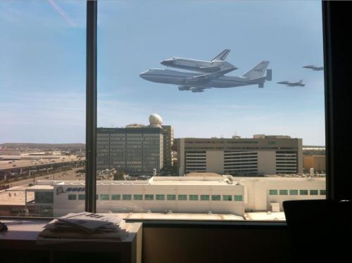incredible pic of Endeavour flying through Los Angeles. taken from inside an ad agency just south of LAX, when the shuttle was about 300 feet above ground level. [credit to Jason Rappaport @jasonrap]