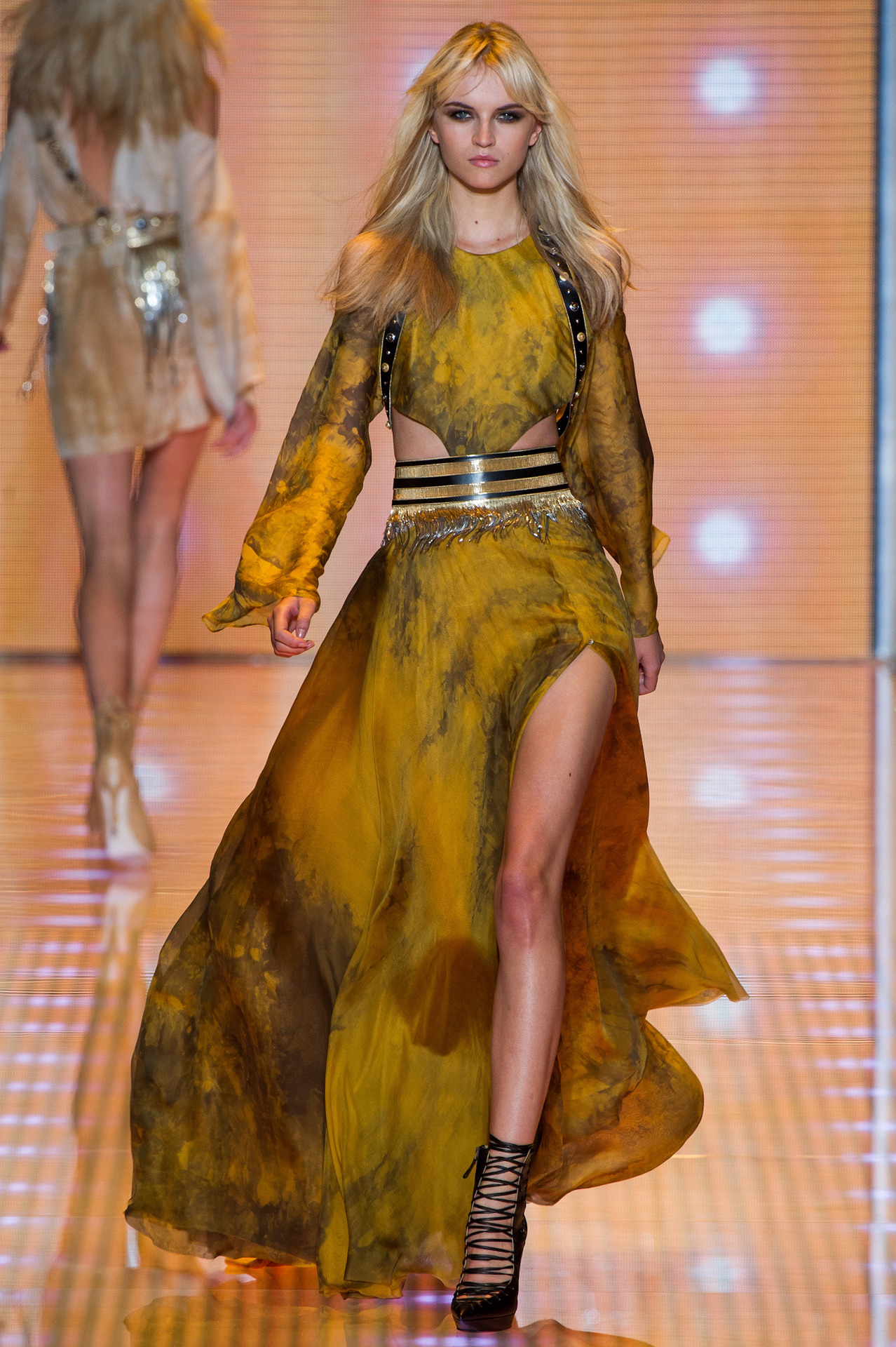 wetheurban:  #MFW: VERSACE SPRING/SUMMER 2013 This season for Versace, Donatella Versace tapped to her inner hyper-feminine sex goddess for inspiration. The collection, presented in Milan today, is filled with delicate sensual touches including lace embellishments with an array chiffon creations taking the lead role. Pale blues, greens, and oranges dominated the collection - taking form in lingerie pieces, cocktail dresses, and (our favorite) long, floating evening gowns. Love! Ol' girls still got it!