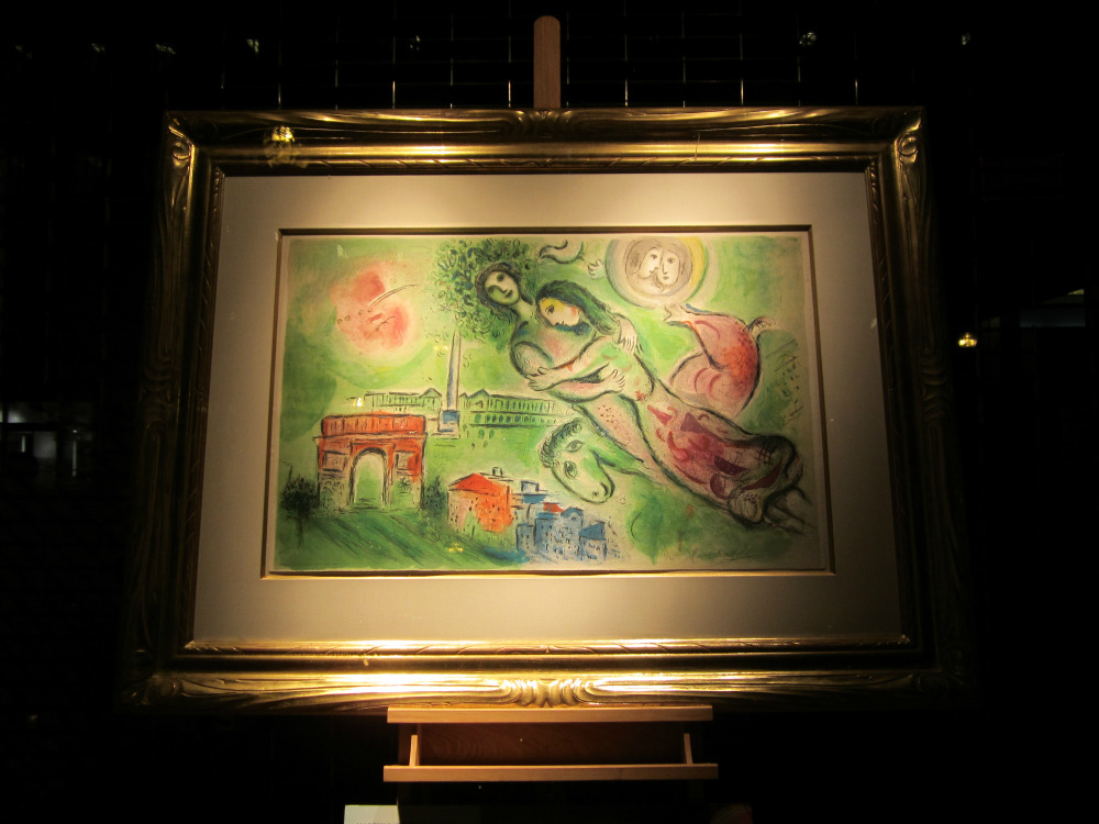 A Marc Chagall print in the window of a Newbury St. gallery at night.  Boston, MA