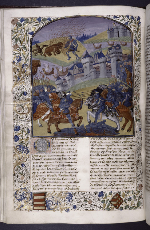 collective-history:  Opening of Book VIII, with miniature showing various scenes from story of Troy, initial, border design, coats of arms.