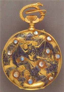 "hostofsparrows:  A RARE ART NOUVEAU ""BUTTERFLIES AND BATS"" POCKETWATCH, BY RENE LALIQUE Of gilt-finished jeweled lever movement, the openface pocketwatch of circular outline with blued-steel moon-style hands and applied black enameled Arabic numerals, against the gold ground accented by blue and white enameled fluttering butterflies, within a polished gold case, the reverse depicting numerous flying purplish blue enameled bats, with scattered moonstone accents, further embellished by a sculpted gold serpent bow, circa 1899-1900, with French export marks."
