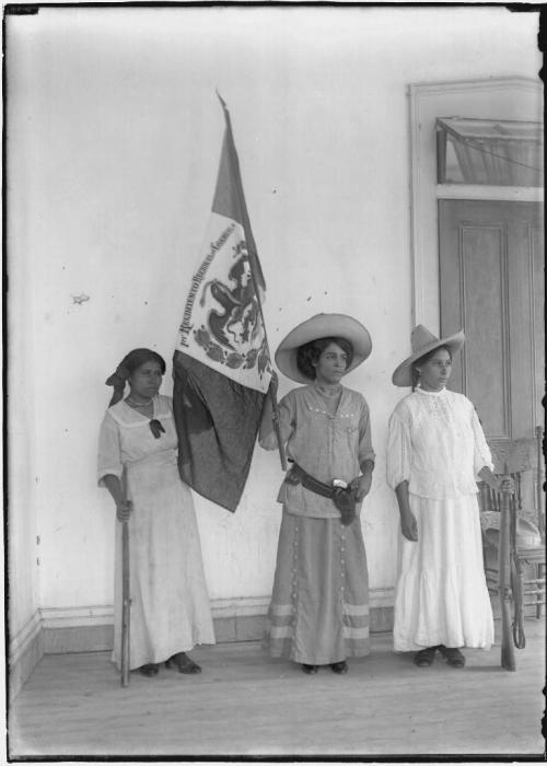 Maria Gonzalez and soldaderas, South Texas border 1900-1920. Soldaderas were female soldiers who fought alongside men during the Mexican Revolution (1910-1920).  The word is also used to refer to camp women who traveled with the troops but did not fight. According to Onda Latina at the University of Texas:  Maria Gonzalez was part of Cruz Blanca, an organization formed in Laredo to provide medical aid for the soldiers and volunteers in Venustiano Carranza's armies. The women in Cruz Blanca made their way to battlefields, often provided their own armed protection while in movement and raised their funds in cities across the United States and Northern Mexico. Their key organizer, Leonor Villegas de Magnon, based herself out of Laredo, and wrote a fictionalized autobiography about her work with armed reform movements in Mexico and South Texas. Robert Runyon was the society photographer in Brownsville and Matamoros, and was called on to offer his services when dignitaries came to the border. This photograph reflects the presence of the Revolution in the respectable parts of South Texas society.