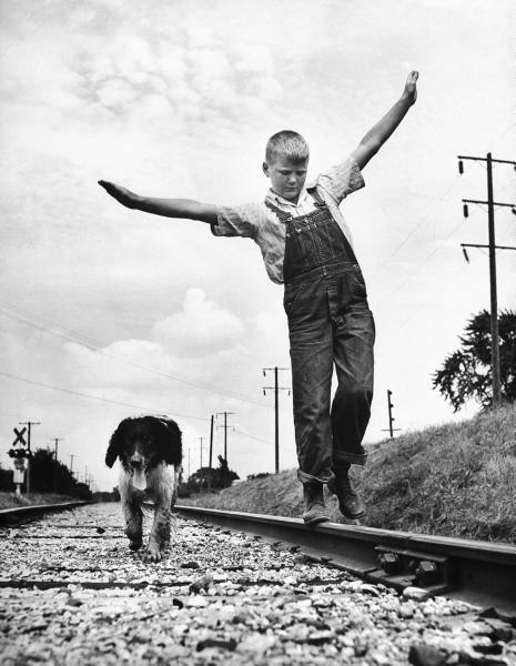 explore-blog:  A boy and his dog by photographer Myron Davis, a visual answer to LIFE magazine's 1989 question of what the meaning of life is