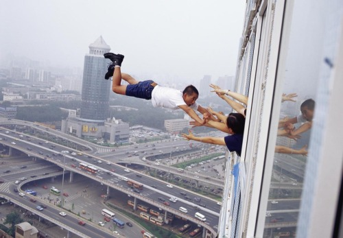 Li Wei, born in 1970, Hubei, China, is a contemporary artist from Beijing. His work often depicts him in apparently gravity-defying situations.www.liweiart.com