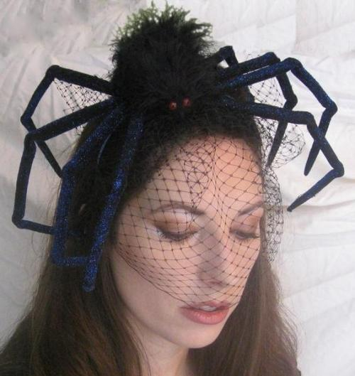 halloweencrafts: DIY Spider Fascinator Originally from Etsy but no longer there. Seen at The Hairpin here. Such an easy DIY - just buy a big spider and attach it to very cheap black tulle or netting.