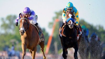 I'll Have Another and Bodemeister duel in the 2012 Kentucky Derby (Photo by John McDonnell)