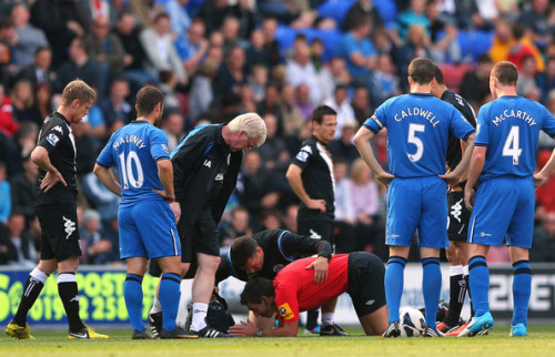 Lee Probert the referee receives treatment after being brought down in a tackle between Ben Watson of Wigan Athletic and Steve Sidwell of Fulham during the Barclays Premier League match between Wigan Athletic and Fulham at DW Stadium. News and LIVE Stream Available at www.nastytackle.comFind us on Facebook :- http://www.facebook.com/pages/Nasty-Tackle/136333106470179