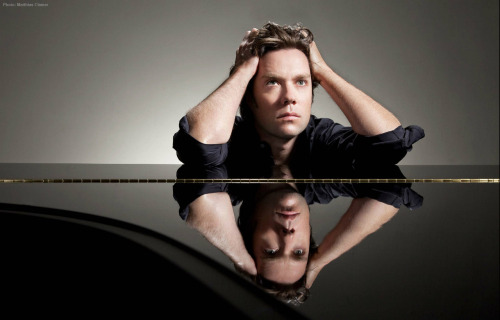 "Rufus Wainwright2010New York City  Photograph by Matthias Clamer for Q Magazine  According to the photographer, this was taken about a week or so after his mother, Kate McGarrigle, had passed away. ""The mood was very somber [..] he played the piano through most of the shoot."" It was shot at Steinway Hall on 57th Street."