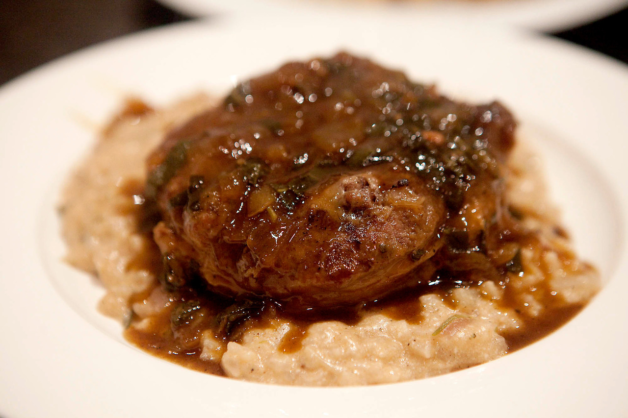 "Chorizo and Caramelized Fennel Risotto I made the beer braised osso bucco for dinner, but the ""side"" was this risotto, meant for leftovers for lunches, but ended up being a meal of its own.  Food overload, once again. Ingredients:  1.5 cups arborio rice 1 red onion, diced 2 tbsp sweet paprika 2 smoked chorizo, sliced 1 fennel bulb, diced 3 tbsp fennel seeds 1 tbsp sugar Butter, salt and pepper 500 ml milk 500 ml chicken stock Water 2 bay leaves 2 sprigs rosemary, diced 1/2 cup ricotta 1 cup grated good quality cheddar 1 cup grated parmesan or similar Saute the onions and fennel in a bit of butter for about 5 minutes.  Add the sugar and fennel seeds, and cook for 5 minutes more until they turn golden brown.  Add the chorizo and brown, then the spices (including salt and pepper).  Add the rice and 2 cups of liquid, simmering and stirring occasionally until it's absorbed.  Add 2 more cups of liquid and repeat.  Once the milk and stock is cooked in, add hot water (or more stock if you have it).  Taste it now and then to see if the rice is cooked through, and with the last round of liquid stir in the cheeses.  Serve warm or freeze for lunches or leftovers dinners."
