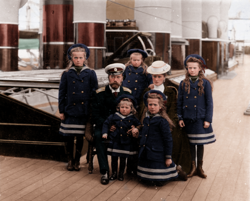 Coloured black and white photo of the Russian royal family on their yacht, the Polar Star. From left, clockwise, we have: Olga, Tsar Nicolas II, Anastasia, Tsarina Alexandra, Tatiana, Maria, and Alexei.
