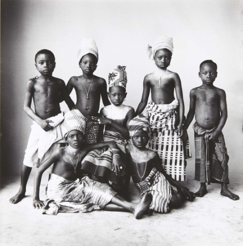 "cosmicyoruba:  dreams-from-my-father:  Dahomey children 1967 by Irving Penn I am not really sure what I should make of this, the fetishisation of brown bodies in western society (purposely left in the singular). And I wonder isnt it the top of westernisation when us, black people and especially African people start circulating and collecting these pictures and are somehow fetshising 'ourselves', not  in the same way whiteness does blackness but with this sense of nostalgia for a past that never was, fantasies about what it could have been like if we would have remained untouched or untamed by whiteness,  or the pinnacle of our quest for identity: the yearning for a lost paradise far away in time and in space.  I really dont know what to make of this series on Dahomey. Penn is one of my all time favorites but although his portfolio is very diverse for a fashion photographer, this series sticks out so much. What was he looking for?? And I also have all these questions about OUR motives as black people living in this era of globalisation where westernisation is accelerating. Why are we black WESTERNISED people so fascinated by pictures of INDIGENOUS black people?? Why? Seriously, we complain about people like Eric Lafforgue who make a living out of exploiting pictures of indigenous people in Africa, put there name in big while not even acknowledging the objects of their photos as subjects with a fucking name! This is dehumanisation and we somehow support it because our blogs, our fantasies about Africa - and this also include born and raised Africans - are full of such pictures taken by white westerners in their voyeuristic safaris in the 'wilderness'. So where does the fascination comes from?? I can only speak for myself here but first of all I need to explain why these kinds of pictures taken by white people is exploitative, fetishising, dehumanising and harmful to indigenous people. I was asked this question and I am using this opportunity just to answer it. Pictures of white people that are taken and circulated in the mass media represent either celebrities, models or people selling or marketing something, or people with a story, a message or something that makes them special and stand out negatively or positively. NEVER EVER are white people photographed simply because they are white! They may be exotified but never fetishised for their whiteness! I am going to just give an example because it is very hard to explain it. I have lived in two of the most touristic places in the world and never have I ever seen a tourist - westerner or not - take pictures of a random person on the streets just because that person just happen to be a Londoner or a Parisianl. When tourists from around the world come here, they take pictures of places, objects, monuments, well everything that represent the 'Other', the exotic, this is at the heart of the tourist experience. White people / westerner don't represent the 'Other'! Whereas when tourists - westerners or not - visit the global South, their 'Other' are the 'locals', who are considered weird/exotic/different/strange little entities in themselves, not relatable human beings with as much depth and complexity. Racism was built on this principle. The problem with 'otherisation' is the fact that it is almost always the premise to dehumanization and commodification which inevitably lead to exploitation. Well we can see the damages today of the tourism industry on indigenous people around the world. So I was wondering why do we, black people, fall for it too and I have to look back at my experience and realised that, though I understand the appeal for indigenous African cultures, I haven't always felt this way. The more I got westernised - a process that accentuated with me moving here - the more I felt growing inside me this need for that lost paradise, that fantasied, utopian, idyllic Africa as a refuge and also as a reaction, as a defence mechanism to constantly be in full contact with the poison of whiteness. To be at the heart of whiteness exposes you in a very peculiar way to its threat. What is weird though, is the fact that in the west, I am ALWAYS defined by something 'othering' such as black, African, PoC or whatever else. I am never just me like white people get to be! Yet I am trying to escape my 'otherisation' by seeking refuge in 'othering' pictures of indigenous African black people. This for me, is the ultimate proof that first of all, escapism and denial of our reality as oppressed is not the solution and is highly damageable in the long run, which is why I do not believe in all that reclaiming blackness which is the essence of the 'otherisation' of people of African descent and is also based on all that 'Ancient' and 'Indegenous' Africa as an utopia; Secondly, westerners are still the ultimate definers of who we are; they re-wrote our history and remain to this day the ultimate providers of narratives and images about Africa!! And obviously those images and narratives are deeply anchored into white supremacy! This is also why I have been arguing against that fake 'black unity' crap which is actually western-centric to its core leads a lot of Africans - well I know since I was one of them - to fall for a western definition of themselves and not pursue their narratives or tell their stories with them at the center, from their point of view instead of getting trapped in false identities defined by the WESTERN WORLD, either by white or black westerners.  So from our point of view as black people in the west, our native cultures of fantasies about indigenous cultures serve as refuges which is in stark contrast with the reality of indigenous pictures or everyday people back home. I have noticed that here black migrants take so much pride in their cultures yet back home, the sad truth is that most of us try to get rid of it as fast as possible in our quest for the western nec plus ultra. Those same indigenous peoples who are fiercely fighting for the survival of the culture, for the integrity of their identity are oppressed, humiliated, ostracised and rejected by those of us who have chosen westernisation and completely embrace the fallacious idea of progress through western means. I personally remember how Pygmees and Wodaabe for instance were despised, looked down upon, mocked and ridiculed. Yet their pictures are everywhere on Tumblr. I find this quite pathetic and hypocritical from us westernised Africans. It is tragic to come all the way here to realise that we would never fully integrate something in which we are the perpetual other and that we have internalised our oppression so much that our behaviours and thoughts mirror those of our oppressors.  So in this part of the world, we are seeking refuge in fantasies about indigenous people while back home indigenous people's main threat is us.  Very excellent points, though I don't agree with all of them. My only addition is to the paragraph I bolded. As someone who is interested in African history, I frequently bump into people who believe in what has come to be called ""Afritopia"". That perfect Africa where women knew they place (and it was a place they wanted so therefore feminism is unAfrican har har), where everyone held hands and sang kumbaya (so there was no division based on ethnicity), where (as some would recall having to read yesterday) there was no money or industry, where people lived simple lives and were happy. I'm always amazed at how Westernised this form of thinking is, and it comes as no surprise that most of the people I've encountered who think this way are Africans based in the West. It is quite fascinating how we actually imbibe Western thought and ideology while trying to shun Westernisation and ""reclaim"" our history. In conclusion; down with Afritopia! It never existed.  Yeah I was thinking about writing about some African societies articulte themselves around a modern society and what is generally conceived a the 'traditional' society which is only based on myths and Afrotopian fantasies and are used to validate the oppression of many groups such as LGBT and women. The 'traditional' society is nothing but the remain of an old oppressive western model of society brought by colons who in most cases, where more misogynistic, transphobic and homophobic than many of our ancestors were. We have a totally fucked up and lost sense of tradition."
