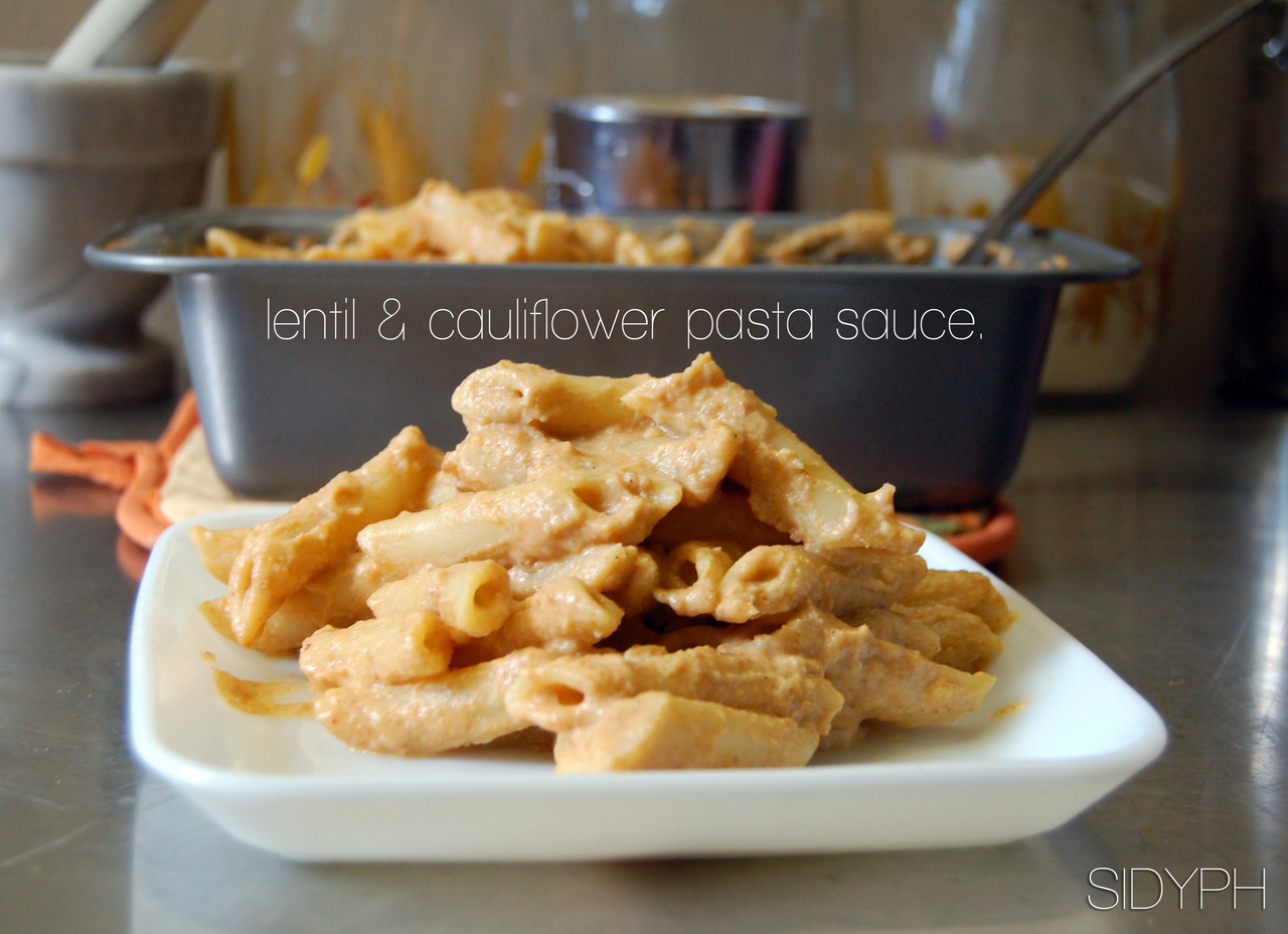 LET'S EXPERIMENT: Cauliflower and Lentil Pasta Sauce It's not everyday that I get to experiment like this.  I typically stick to the same few recipes, and even when I go out of my bubble, I tend to use a lot of the same stuff.  But today I wanted to be a little more creative. I had some lentils and a half head of cauliflower to use up, and was (surprisingly) in the mood for pasta. So there wasn't anything I could do except create a new dish! Shucks.  This is a vegan, gluten-free sauce, that could be classified as a mix between cheese and Alfredo. You can also use white beans if you want it to be the same colour as an Alfredo sauce. And if you do eat cheese, you can grate some in at the end! Everyone wins! Make this because: You'll never have another pasta sauce with this much protein and veggies. Or maybe you will, but it won't taste like this. Fact* Ingredients: 1/2 head, cauliflower 2 handfulls, lentils (drained and rinsed). 2 lrg clove, garlic, minced 1 large, shallot, diced 1 t, nutmeg 3-5 T, Nutritional yeast 1 T, Paprika S&P Soy/Almond milk (roughly 1/2 C) Oil.  Directions: Saute onion/garlic in oil.  Boil cauliflower for 5-7 minutes then drain. Blend Lentils/Cauliflower together and add a little bits of milk at a time until you get the right consistency.  Now add in Gar/Onion, paprika. Blend again and put in saucepan.  Add nutritional yeast (and/or cheese) and stir.  Pour over fav pasta. I baked mine in the oven for 15 minutes at 400•. You can do the same or just dig in!