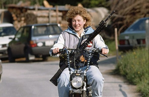 gunsandposes:  Armed civilian woman on motorcycle in Switzerland. Photo by Vittoriano Rastelli. (Time)