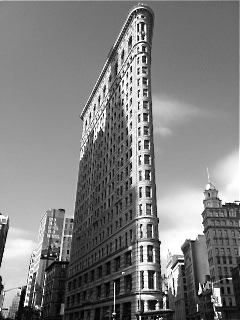 view of the Flatiron Building from Madison Square Park