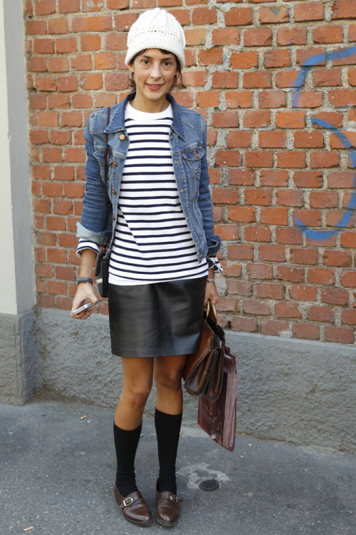 Youthful, fun and sophisticated all in one look! We're liking the offset between the smart leather skirt and playful calf-high socks at #MFW  WGSN Street Shots, Milan