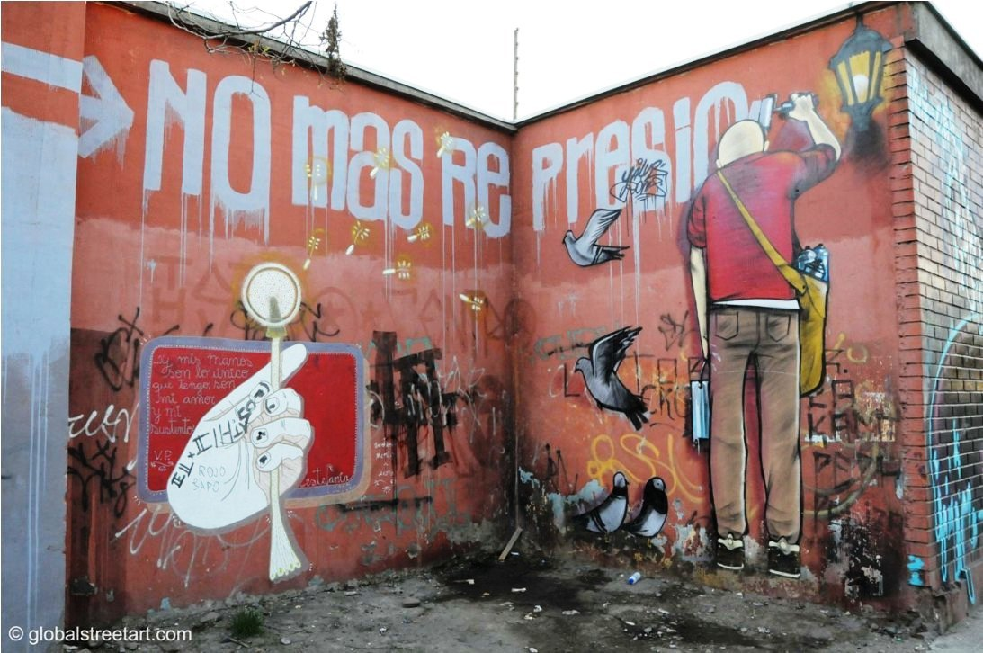 """No More Repression"" from Santiago. I found this last year in my brief 3 day trip to Chile! I love the character painting the piece and the drips coming down from the words. Good use of spray and roller and it works well on the corner wall! Artist unknown."