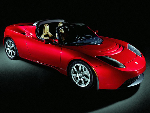 "The Tesla Roadster ""The Tesla Roadster is a battery electric vehicle (BEV) sports car produced by the electric car firm Tesla Motors in California. The Roadster was the first highway-capable all-electric vehicle in serial production available in the United States. Since 2008 Tesla has sold more than 1,500 Roadsters in 30 countries as of March 2011.[2] Tesla began producing right-hand-drive Roadsters in early 2010 for the British Isles, Australia, Japan, Hong Kong and Singapore.[3]  The Roadster is the first production automobile to use lithium-ion battery cells and the first production BEV (all-electric) to travel more than 200 miles (320 km) per charge.[4] The world distance record of 501 km (311 mi) for a production electric car on a single charge was set by a Roadster on October 27, 2009, during the Global Green Challenge in outback Australia, in which it averaged a speed of 25 mph (40 km/h)."" - Wikipedia"