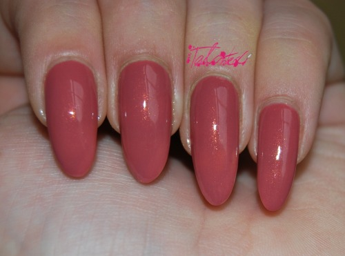 SWATCH: OPI 'Gouda Gouda Two Shoes'… This is my third polish from OPIs 2012 Holland collection. ('Thanks A Windmillion' is reviewed here [on my old square nails which now look AWFUL compared to my points]: http://talonted.tumblr.com/post/18661802839, and 'A Roll In The Hague' is reviewed here: http://talonted.tumblr.com/post/18659514457). This polish dries a lot darker than it looks in the bottle, when I saw it in the airport I thought it looked a bit similar to Chanel's 'Rose Confidentiel' but it is actually a much darker, warm rose colour, with a beautiful coppery-gold shimmer when you see it in the sun. As with most OPI polishes, it is a two-coater and dries super quickly. This is a really nice colour for the oncoming autumnal weather: warm and pretty, girly without being too pink. Perfect. Lex :)