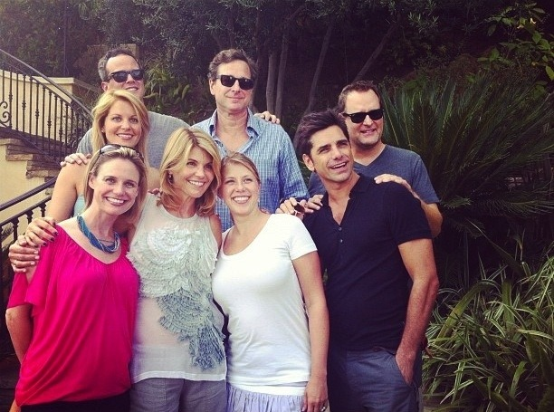 shortformblog:  popculturebrain:  The Cast Of 'Full House' Reunited (Minus the Olsen Twins) | BuzzFeed For the 25th anniversary of the show.  Is it just us, or does John Stamos actually look like he's gotten younger?  He and Andrea Barber (Kimmy, in the pink) look like they're the same age, it's ridiculous.