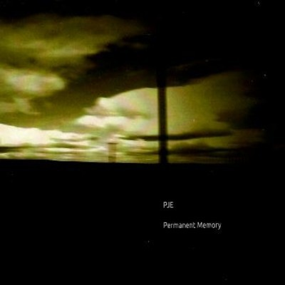 PJE – Permanent Memory 7.3                    Permanent Memory is sad blurriness. There are things going on just at the verge of comprehensibility. Little voices, samples, burr in and out of the meditative drones. With all these samples left unclear it leads to a neurotic urban sense of mind. Sure people are speaking all around us but we process it as a collective mush. Much of this album reflects that same experience. An overall melody guides each one.                   'Calligraphy' barely touches on the usage of field recordings staying completely alone and sad. On the other side of this is 'Delphi' which uses the noises as a form of unsteady rhythm. 'Hilbre Island' almost reaches a level of happiness halfway through. It longs for a happier tone and PJE appears to reach for it yet ultimately miss. The tension in this piece makes it particularly memorable. By the end the mood almost appears to shift. 'Promenade' is nearly calm in nature. 'One Summer' is pure calm. Here is where PJE explores a different aspect in his music. Yes the static samples remain yet there is clarity here. The usage of gentler tones makes it feel like waking up in the morning.   Disembodiment in urban life is rarely articulated this well. PJE understands the simultaneous togetherness and loneliness of living in a city. These nine pieces attest to it. Simply play them loud and walk around. You'll be amazed at how much be defines the aural concept of the modern city.