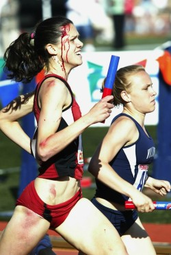 "flatabsandthighgaps:  bendoeslife:  Stanford runner Alicia Follmer trampled during a race gets back up and finishes in third place.  Amazing picture. Article here.  (Pasting the article because it was interesting)   Blood can paint an indelible portrait, as Alicia Follmar learned last spring. The Stanford runner was just over a lap into the first leg of the distance medley at the Penn Relays in Philadelphia when she was tripped accidentally from behind. She fell hard, and six or seven runners appeared to go straight over her.  What happened next was captured in unforgettable photos: Follmar got up quickly and regained her stride, while long streams of blood flowed down her face and neck. She had been spiked in the forehead, showed nasty abrasions up and down her right side and generally looked liked someone running in the Freddy Krueger Invitational.  As she powered her way from 10th to third over the remaining two laps, she ran into Internet-lauded fame. There's far more to the two-event All-American than that one race, but no pictures of her are anywhere near as memorable.  ""I wouldn't say it was as bad as it looks … . I can't say it really hurt, there was so much adrenaline,"" says Follmar, now a senior. ""There was a feeling that I had in my head—like a sensation in my head—so I felt my head with my hand and looked at it, and there was blood on it. At that point, I was already running. I kind of panicked, but I still kept running."" Stanford finished third.  All the best clichés—dedication, determination, tenacity—can be justified by that performance alone. But Follmar, a human biology major who is applying to dental schools, is intent on overachieving throughout her last year of running at Stanford. She was the women's champion in the opening cross-country meet, the August 30 USF Invitational, serving immediate public notice that she has ""big goals"" for every event in which she competes. She hasn't made a checklist of objectives that span the cross-country, indoor and outdoor seasons because, basically, she wants to do it all.  ""I don't really know what I want,"" she says, thinking out loud. ""I want to be All-American. I want [Stanford] to win a national championship again in cross-country. I just want to be one of the best in the nation."" Stanford has taken the title three years in a row.  Whatever Follmar accomplishes, it will be rooted in a fortitude that became conspicuous during high school in Saratoga, Calif. She was a sophomore when well-known Saratoga High track coach Marshall Clark collapsed and died at practice.  Clark, an assistant coach at Stanford from 1968 to 1978, was renowned for his leadership, and his impact on Follmar turned out to be profound and poignant. Debbie Follmar, Alicia's mother, remembers how shaken her daughter was by Clark's death. ""She got on her cell phone,"" she recalls, ""and she was crying hysterically. I finally made out that Marshall had died, and I couldn't believe it. Then I started crying, too.""  Six years later, Alicia Follmar remains conscious of how powerfully she was influenced by Clark's life and death. ""I'm not crying about it at night anymore and stuff like that. But it's still, you know, on my mind… . It's kind of nice to be able to run in his memory a little bit.""  After Clark died, says Follmar, the Saratoga High runners looked to each other for emotional support, and she found a strength and self-confidence that seemed almost new to her personality. Today, it is those qualities that define her in the minds of others.  ""Committed is the word,"" says Edrick Floreal, Stanford's director of track and field. ""There's a level of commitment that goes toward her team and Stanford that is unparalleled.""  Follmar, 5-foot-10 with a big back kick, has run since she was very young, sometimes with her mother, who has logged six miles a day for 35 years. Alicia was a state champ in the 1,600 meters as a high schooler; at Stanford, she won All-America status in the indoor mile and distance medley relay as a junior.  If everything clicks, Follmar may have people talking about numerous athletic moments besides the Penn Relays exploits. The problem, though, is how rich in detail that one blood-streaked day is.  Consider this: one of her three older brothers is a plastic surgeon who was at the race. The family is still talking about how much he would have preferred to stitch up his sister's spike wound instead of its being done by the podiatrist on duty. There's also the dramatic residue. One lap of merely running, then two laps of courage.  ""As much as I was unhappy that she got hurt,"" says Floreal, ""I was pleased that people could see what Alicia Follmar is like."""