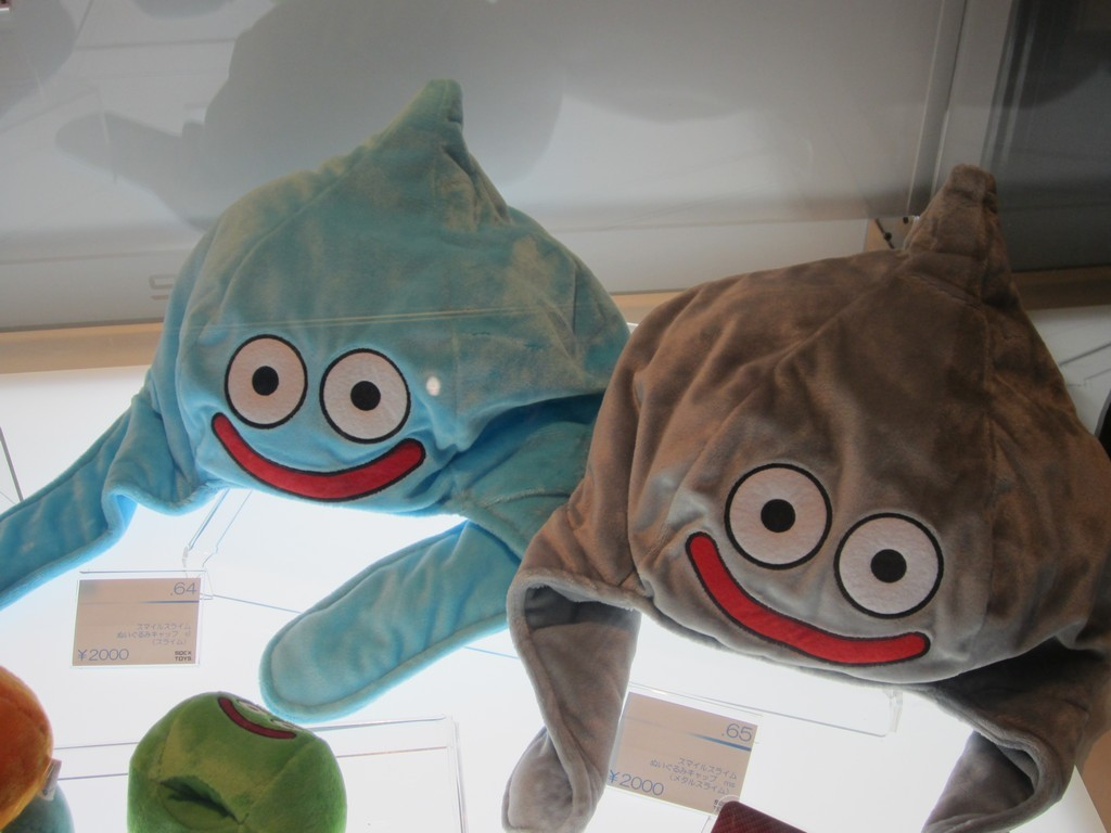 Slime hats! Joystiq's Jordan Mallory spotted these in Square Enix's TGS shopping area. The stuffed caps sell for ¥2,000 each ($25.63), and I'm not sure I could pull it off. By which I mean I'm not sure I'd ever remove it once I put it on. Buy: DQM Joker 2, More Dragon Quest gamesSee also: More Dragon Quest posts