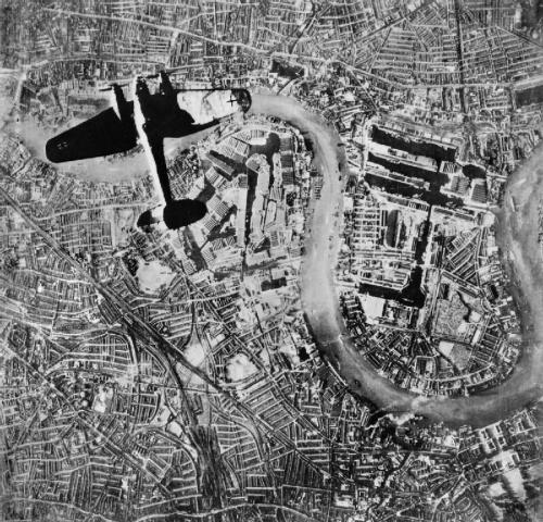 ww2inpictures:  A German Heinkel He 111 medium bomber over the East End of London, England - 7th of September 1940.