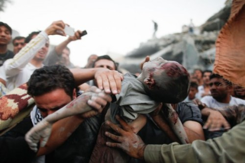 simply-war:  The body of a Syrian child is pulled from rubble after an aerial bombardment from goverment forces in the Ahad neighbourhood of the northern Syrian city of Aleppo, Sept. 11, 2012. Sam Tarling.