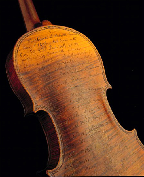 thecivilwarparlor:   Solomon Conn's Violin Diary On May 1st, 1863, Solomon Conn bought a violin in Nashville, Tennessee. By the end of his years as an infantryman in Company B of the 87th Indiana Volunteers, he'd re-purposed it into a diary, inscribing its wood with a list of his travels—one of the most unusual artifacts to survive the Civil War.   oh my GOD