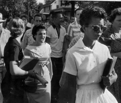 patron-saints:  Fifteen-year-old Elizabeth Eckford endures with dignity the jeers of a white mob during the desegregation of Little Rock Central High School.