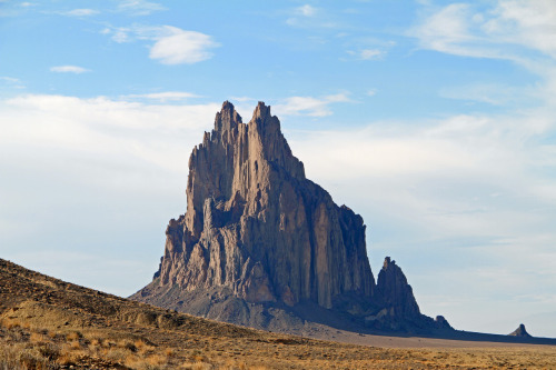 "scinerds:  Shiprock  Shiprock gives the impression of having been volcanically thrust out from the sands of the Mancos desert, but this isn't the case. Shiprock is indeed a volcano but of a class called a ""diatreme"", having formed explosively from gas-charged magma escaping at great velocity. It possessed a crater at the surface called a ""maar"", but erosion has long since removed it along with much of the sedimentary strata through which it erupted."