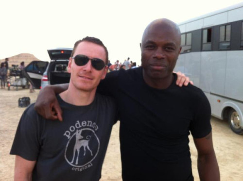 sweetpeainadysfunctionalpod:  Michael Fassbender & Christopher Obi on set of 'The Counselor' 9/24