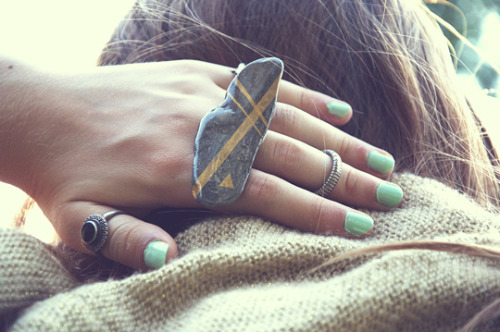 DIY Easy Gold Striped River Rock Ring Tutorial from The Perfect Pear here. At first I thought this was a double ring, but this project only uses one ring base.
