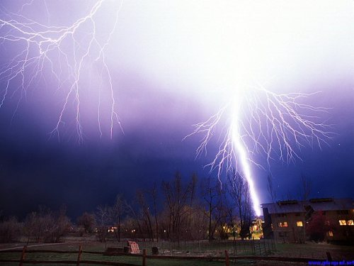 lightning strike hitting a condo house in fort collins, colorado.