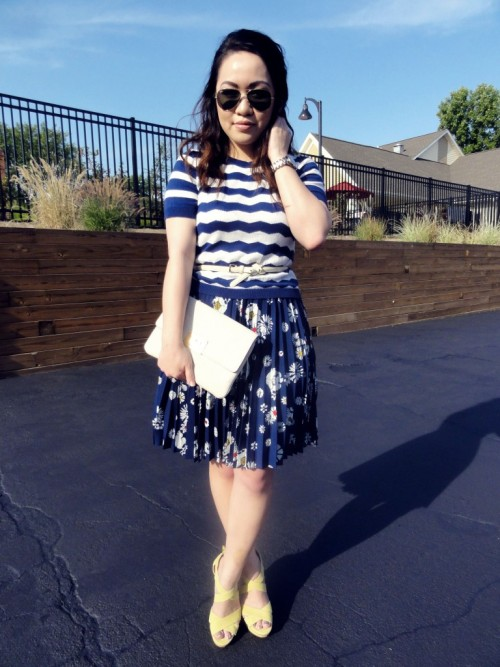 I love everything about this outfit. Stripes, floral, clutch & great heels. via @joleskhor. Check out her fashion blog: Stylescraper