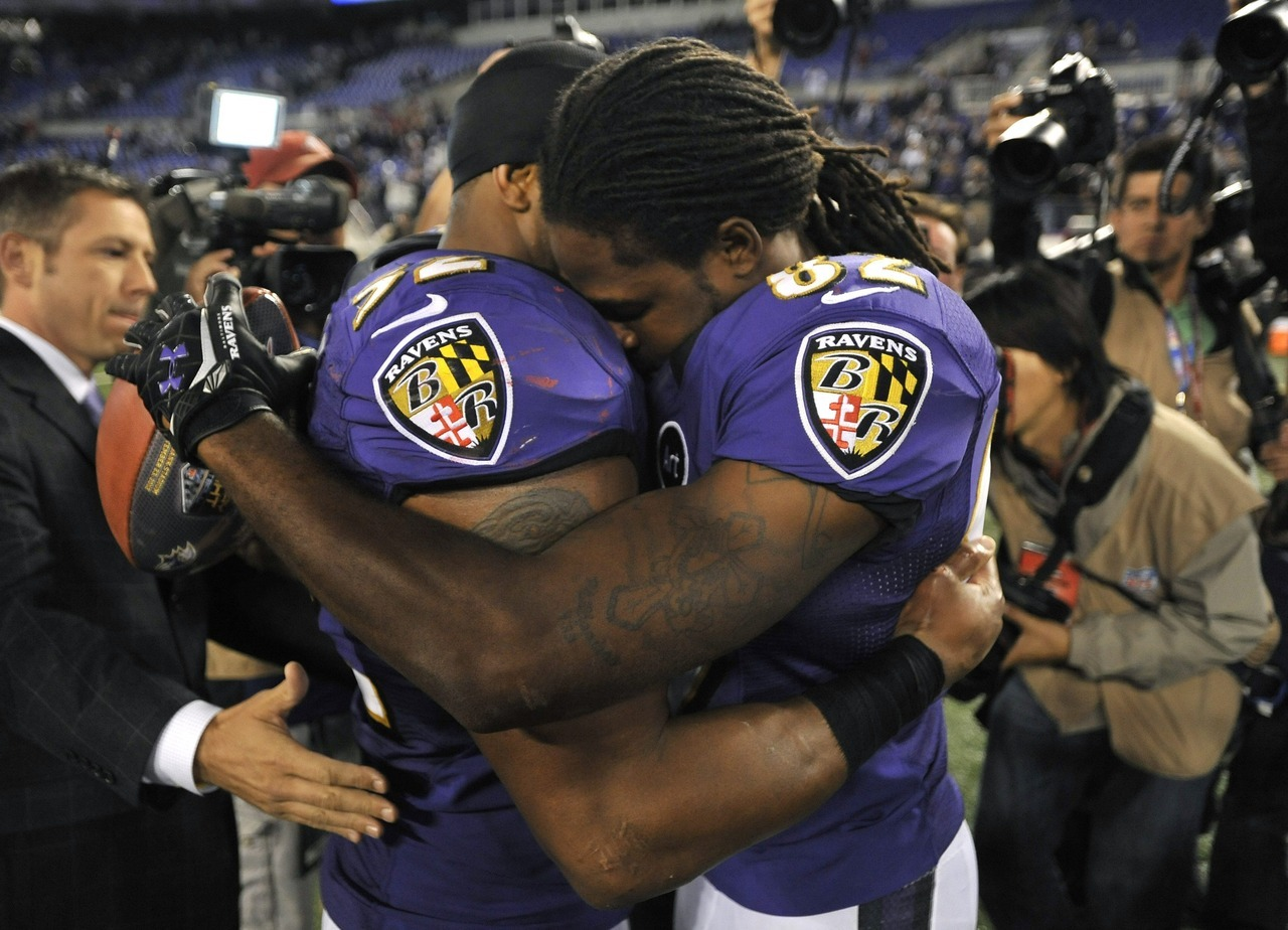 "nationalpostsports:  Ravens linebacker Ray Lewis, left, hugs wide receiver Torrey Smith after an NFL football game against the New England Patriots in Baltimore. Baltimore won 31-30. Smith, who was playing less than 24 hours after the death of his 19-year-old brother, had six catches for 127 yards and two touchdowns for the Ravens. Tevin Jones, 19, died late Saturday night in Virginia. Smith left the team hotel at 1 a.m. Sunday and spent much of the day with his family before heading back to Baltimore.""I texted my mom when I got to the stadium. That was when I knew I was going to play,"" Smith said. ""She was excited about it. She said, 'He'd want you to play.""'"