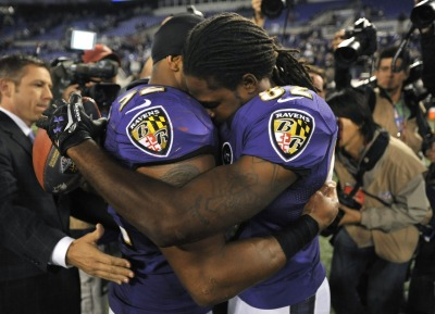 "Baltimore Ravens linebacker Ray Lewis, left, hugs wide receiver Torrey Smith after an NFL football game against the New England Patriots in Baltimore. Baltimore won 31-30. Smith, who was playing less than 24 hours after the death of his 19-year-old brother, Tevin Jones…""I texted my mom when I got to the stadium. That was when I knew I was going to play,"" Smith said. ""She was excited about it. She said, 'He'd want you to play.""'"