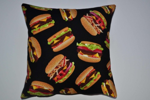 The new site is now up, featuring brand new items such as the Burger Cushion. Go have a browse of the new stock and don't forget to check out the HALLOWEEN hair accessories. www.thenightofthelivingthread.com