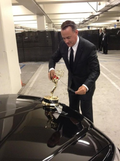 Tom Hanks Tapes Emmy to Hood of Car I mean what are you gonna do with an Emmy, keep it on your fireplace?