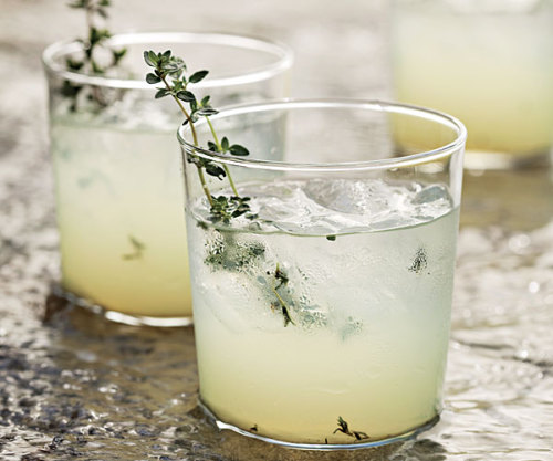 parlourtreats:  Limoncello- Gin Cocktail with Grilled Thymed 2 large sprigs fresh thyme; more for garnish 1/2 fl. oz. (1 Tbs.) fresh lime juice 1-1/2 fl. oz. (3 Tbs.) gin, preferably Bluecoat American Dry 1/2 fl. oz. (1 Tbs.) limoncello, preferably Averna Limoni di Sicilia  Prepare a gas or charcoal grill fire for direct cooking over medium-high (500°F) heat. Grill the thyme sprigs until fragrant and lightly charred, about 15 seconds. In a mixing glass or cocktail shaker, gently muddle the grilled thyme with the lime juice. Add the gin and limoncello and fill the shaker with ice. Stir well. Strain into a chilled rocks glass filled with fresh ice, garnish with thyme, and serve.