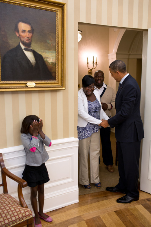 Eight-year old Make-A-Wish child Janiya Penny reacts after meeting President Barack Obama as he welcomes her family to the Oval Office, Aug. 8, 2012. (Official White House Photo by Pete Souza)